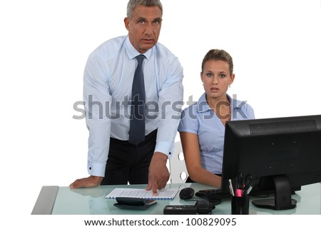 A businessman posing with his secretary