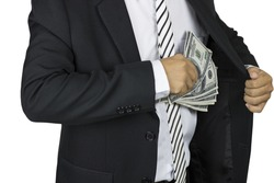 A businessman putting one-hundred dollar banknotes into the chest pocket on white background, saving and banking concept