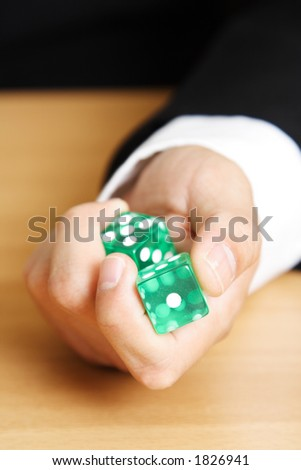 A businessman rolling a dice