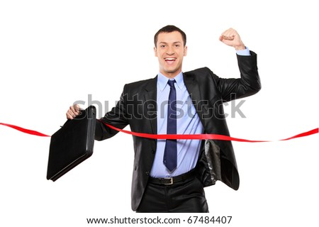 A businessman running at the finish line isolated on white background