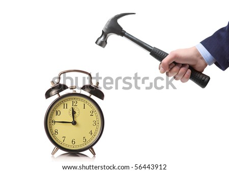 A businessman's hand about to break an old clock isolated on a white background
