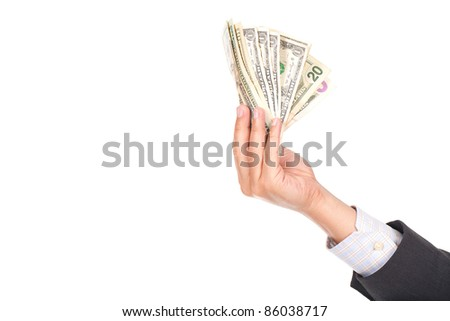 a businessman's hand holding a lot of dollar bills