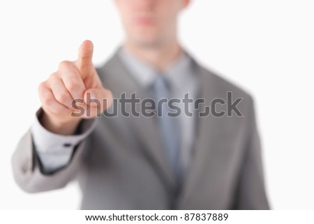 A businessman's hand touching something against a white background