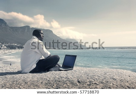 a businessman's working on the beach