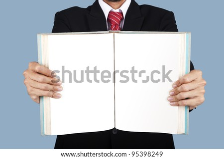 A businessman showing a blank pages of a book