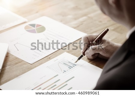 A businessman sign or discussing document or graph.Close up shot.Vintage or pastel effected photo