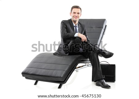A businessman sited on a sofa isolated on white background