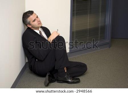 A businessman sitting in the corner