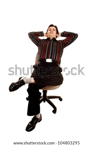 A businessman sitting on his office chair in dress pants and a striped shirt relaxing with his hands behind his head for white background.