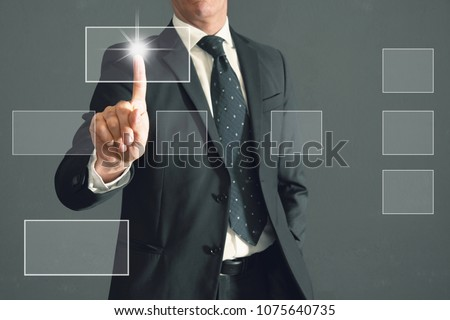 a Businessman touches a virtual screen #1075640735