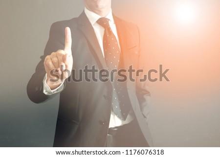 a Businessman touches a virtual screen #1176076318