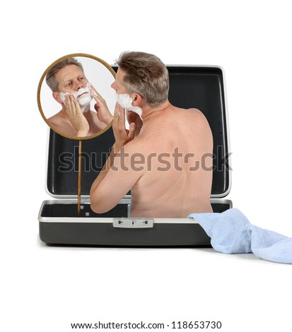 A businessman travels so much he lives out of his suitcase - stock photo