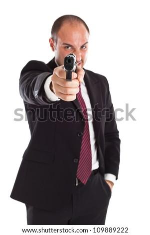a businessman with a gun (focus on gun)
