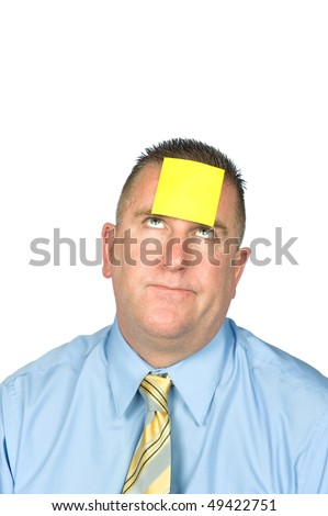 A businessman with a sticky note on his forehead.