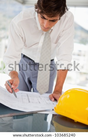 A businessman with blueprints of a building