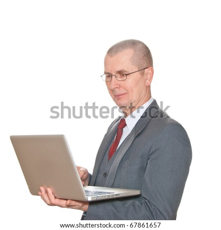 A businessman with glasses and laptop isolated on white.
