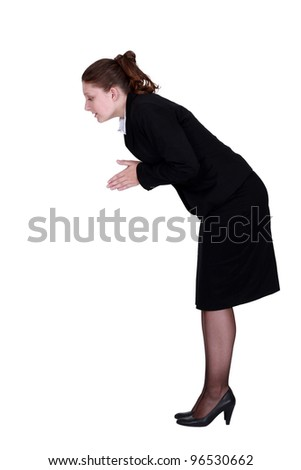 A businesswoman about to dive.