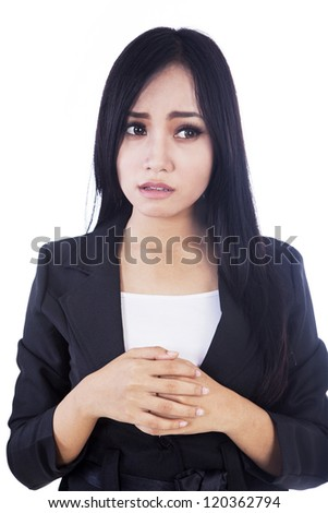 A businesswoman afraid of something isolated in white