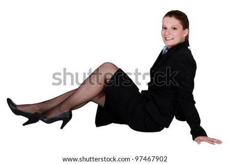 A businesswoman laying on the floor.