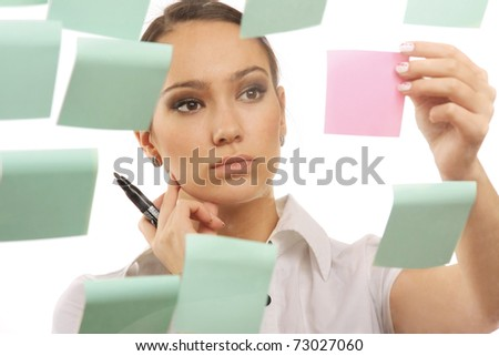A businesswoman looking at stickers