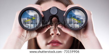 A businesswoman looking through binoculars, seeing conflicting trends in earnings prediction, can be used for business vision or business prediction concept - stock photo