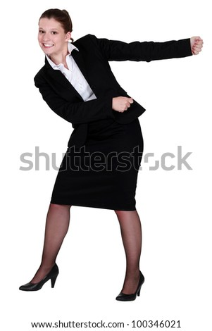 A businesswoman miming.