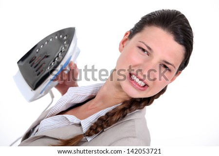 A businesswoman unhappy with her ironing.