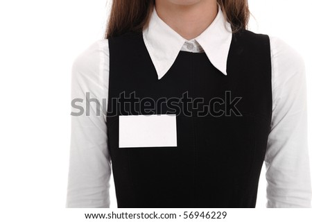 A businesswoman wears a blank name tag.