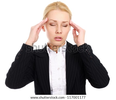 A businesswoman with a headache holding head, isolated on white background