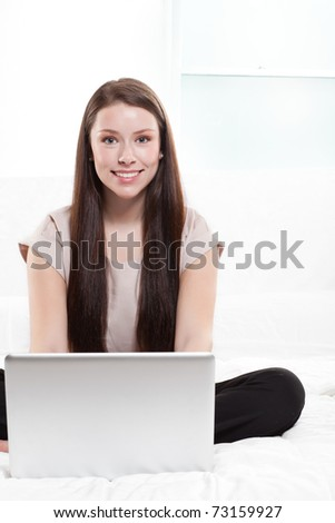 A businesswoman working on her laptop at home