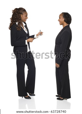 A businesswoman writes down answers on a questionnaire or fills out forms during an interview.