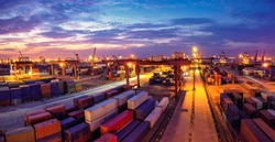 A busy container terminal at night