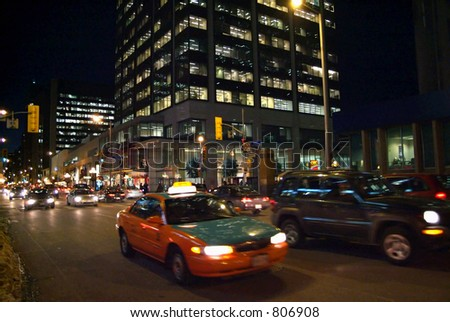 A busy downtown street at night.