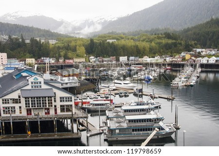 A busy harbor in Ketchikan, Alaska full of yachts, fishing boats and sailboats
