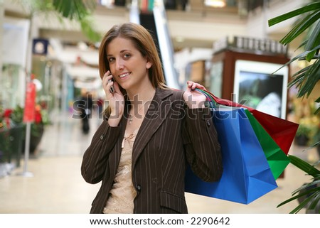 A busy woman shopping and talking on the phone