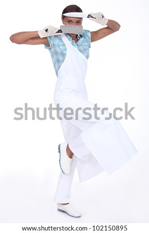 A butcher holding her paring knives - stock photo
