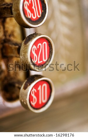 A 20 button on a retro dirty cash register - shallow depth of field