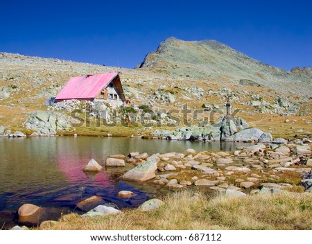 A cabin and a glacial lake up in national park Pirin, Bulgaria