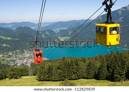 A cableway is bringing tourists up the zwolferhorn mountain near the city of st.Gilgen in Austria