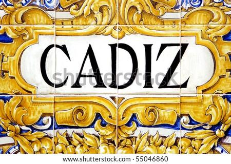 a Cadiz sign writen in mosaic tiles