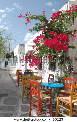 a cafe setting in the greek islands with beautiful flowers Paroikia Paros Cyclades Greece island