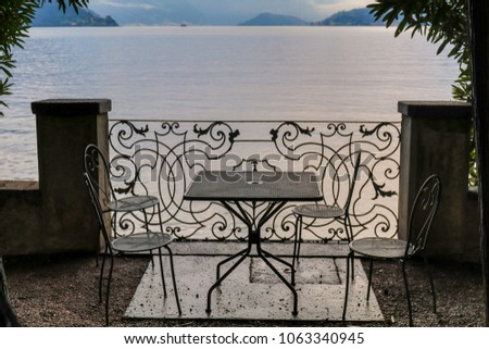A cafe table with chairs in a lakeside - Shutterstock ID 1063340945