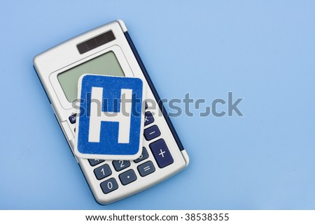 A calculator and a hospital sign on a blue background, calculating healthcare costs