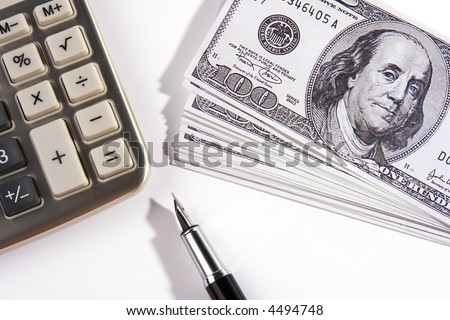 A calculator and some US dollar bill.