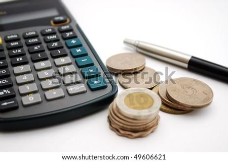 A calculator , pen and coin