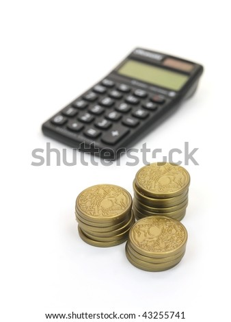 A calculator with play money isolated against a white background