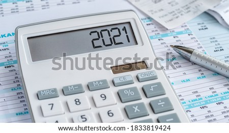 A calculator with the 2021 on the display Stock photo ©