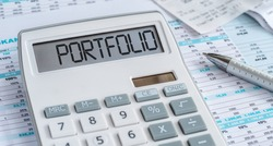 A calculator with the word Portfolio on the display