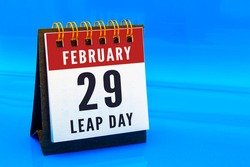 A calendar page on February 29 on a leap day on a blue background. Concept: Leap Year