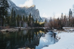 A calm lake surrounded by trees in Yosemite National Park, California, USA